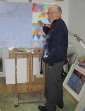 Artist John Sprakes at his easel
