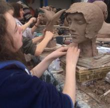 Teenager creating a medieval lady's head