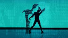 Silhouetted dancer against a blue background